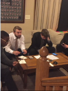 Pike Health and Safety Director Alex Schmidt (middle) and chapter President Tyler Kobussen (right) fill out bid cards for their new members