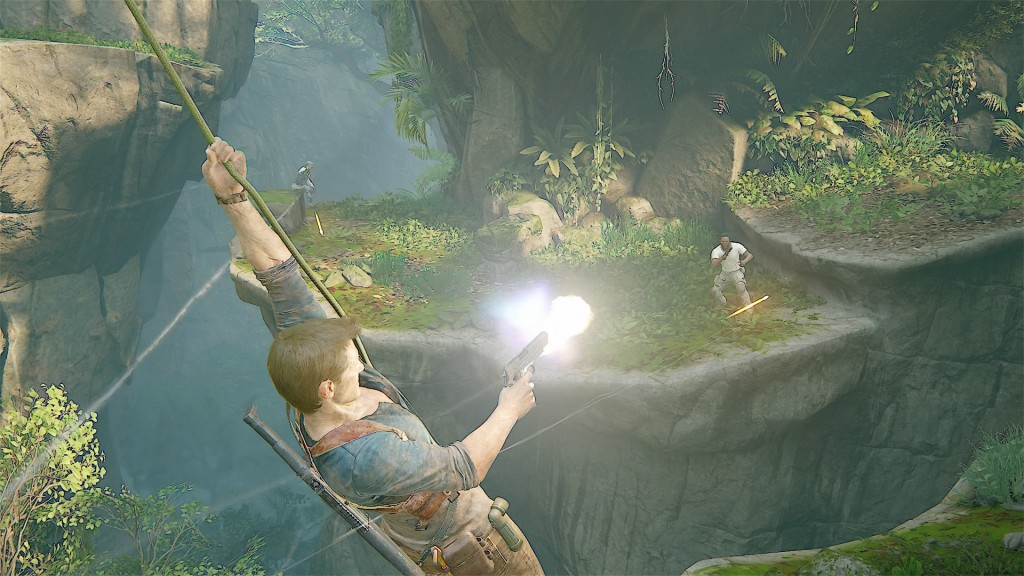 Nathan Drakes swing across a chasm using his grappling hook while firing his gun at enemies on the other side.