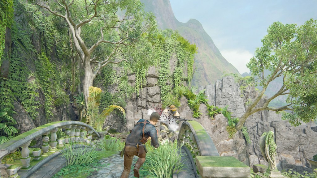 Nathan Drake runs at an enemy with a shotgun, fires it, dispatching the enemy.