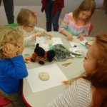 photo of children making fossil craft with clay