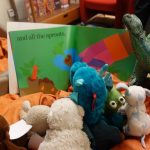 stuffed animals reading a book
